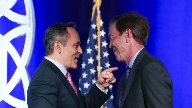 Governor Matt Bevin, left, greets Braidy Industries CEO Craig Bouchard during the Governor's Local Issues Luncheon held at the Galt House.  Bouchard's company is building a $1.3 billion aluminum mill in eastern Kentucky.