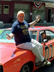 Actor Ben Jones on one of the 229 hotrods adorned with