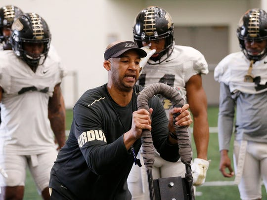 Cornerbacks coach Derrick Jackson with instructions for the cornerbacks during Purdue spring football practice Friday, March 23, 2018, inside the Mollenkopf Athletic Center.