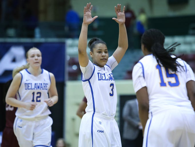 Delaware guard Erika Brown (center) puts her arm up in celebration as the Blue Hens advance to the CAA Finals tomorrow as they defeat the College of Charleston 60-52 Saturday, March 15, 2014.