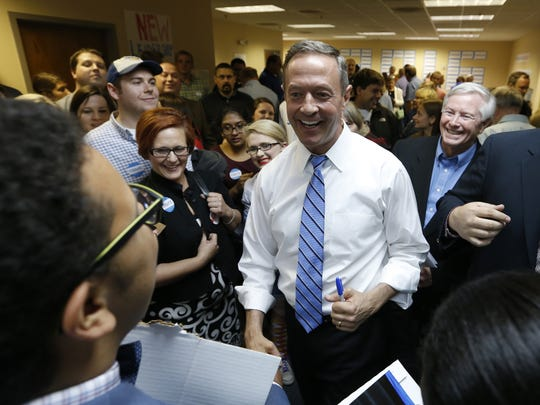 Democrat Martin O'Malley, a former governor of Maryland, talks with Gabe Aderhold, left, and Abena Abraham, both of Minneapolis, during a campaign stop in Des Moines, Iowa, on Saturday, May 30, 2015.