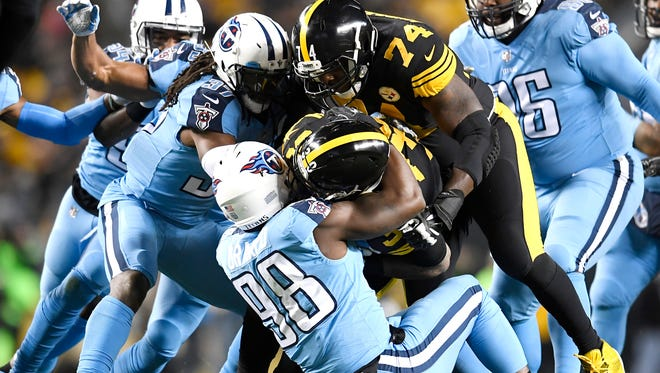 Titans linebacker Brian Orakpo (98) stops Steelers running back James Conner (30) in the first quarter at Heinz Field Thursday, Nov. 16, 2017 in Pittsburgh, Pa.