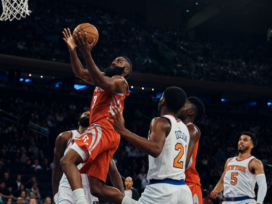 Houston Rockets' James Harden drives to the basket