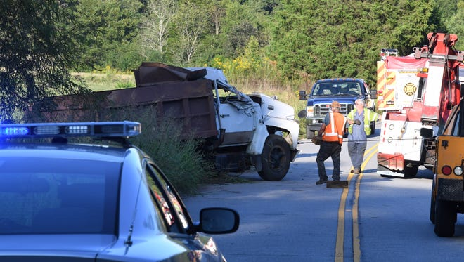 Troopers investigate a fatal crash involving a dump truck in Star Tuesday.