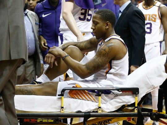 Isaiah Canaan is taken off the court after a gruesome ankle injury in January.