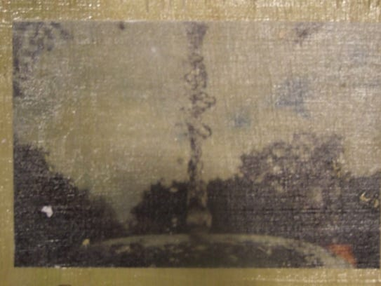 This wood-block photo transfer, made by Madeleine Brugman