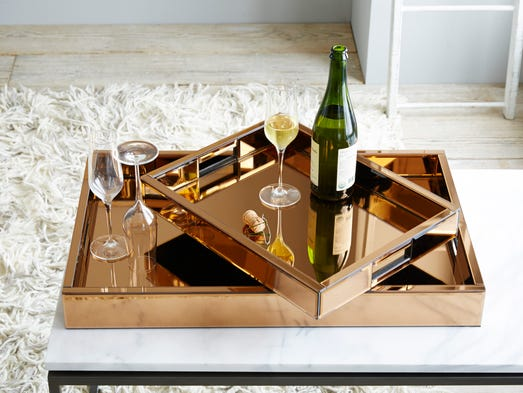 Mirrored copper trays, $89 to $149.