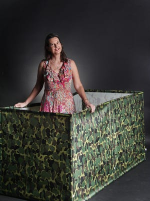 Ingrid Setzer of Cape Coral has patented her portable privacy enclosure, a product she has been working on for 14 years.