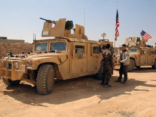 Syrian Democratic forces standing near U.S military