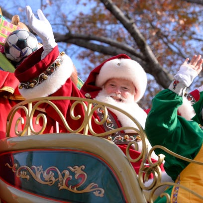 Santa waves to the crowd during the parade.