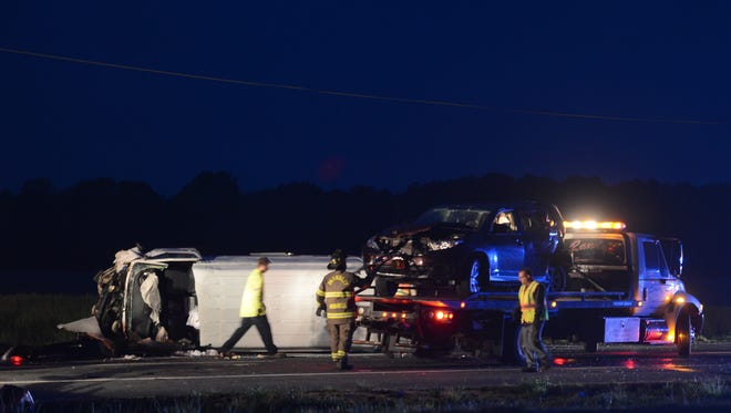 Firefighters and police work a four-vehicle crash in the southbound lanes of U.S. Route 13 in Tasley, Va. on Friday, April 29, 2016. The crash happened before 8 p.m. on Friday and closed both southbound lanes of the highway.