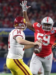 Ohio State defensive lineman Tyquan Lewis (59) closes