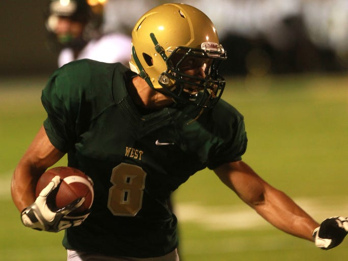 West High wide receiver Oliver Martin runs down field during the Trojans' game against Cedar Rapids Kennedy on Friday, Aug. 29, 2014. David Scrivner / Iowa City Press-Citizen