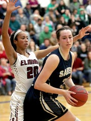 Susquehanna Valley's Maeve Donnelly looks to protect the ball from Elmira's Zaria DeMember-Shazer during theSouthern Tier Athletic Conference girls basketball championships, Elmira vs. Susquehanna Valley, held at Maine-Indwell High School, February 14, 2018. Susquehanna Valley won with a final score of 45-66.