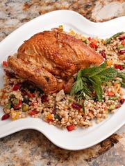 Roasted chicken with rosemary and lemon over roasted vegetable couscous with almonds and mint from chef Chaz Frankenfield of the Sheraton Phoenix Downtown.