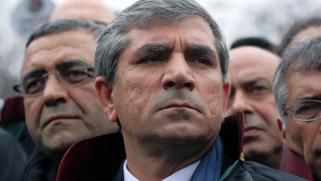 FILE - In this Feb. 16, 2015 file photo, Tahir Elci, the head of Diyarbakir Bar Association, , walks with thousands of lawyers to the parliament in Ankara, Turkey.