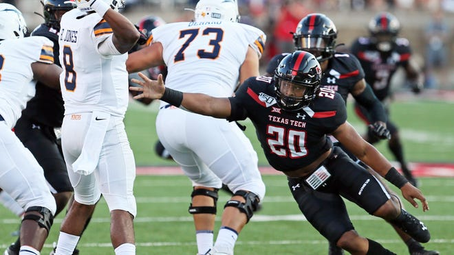 Texas Tech's Kosi Eldridge (20) pressures UTEP's Brandon Jones (8) during a 2019 game at Jones AT&T Stadium. Eldridge, an all-state but undersized linebacker at Denton Ryan, has put on about 50 pounds to since to earn playing time in the Big 12.