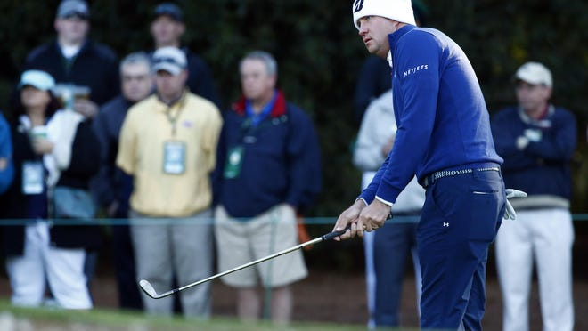 Former Maclay golfer Hudson Swafford chips onto the 1st green during the second round of The Masters golf tournament at Augusta National Golf Club Friday.
