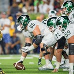 Michigan State center Brian Allen (65) prepares to snap the ball in the second quarter against Notre Dame on Saturday in South Bend, Ind.