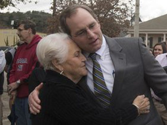 Carol Parker Nunnery embraces Bill Eskridge, a lawyer representing the Historic Prattville Redevelopment Authority, after they won a mortgage foreclosure auction of Daniel Pratt's historic cotton gin factory in 2015. Nunnery's body was found Tuesday, and her death has been ruled a homicide.
