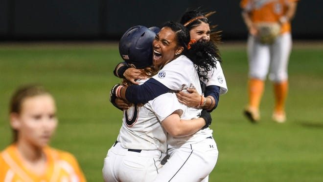 Jade Rhodes celebrates after Auburn won the SEC Tournament championship game Saturday, May 9, 2015 in Baton Rouge, La.