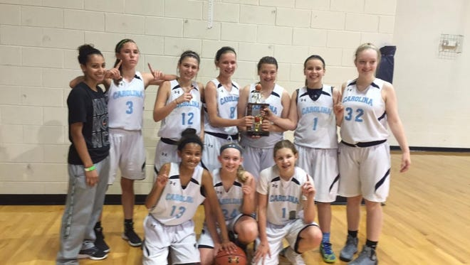 The Team Carolina - Asheville 14U girls basketball team.