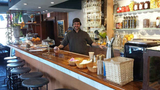 Jeff Toolan, owner of the The Hotel Groton, at the counter/bar;