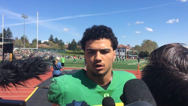 Oregon linebacker Troy Dye talks to the media Saturday at Jesuit High School.