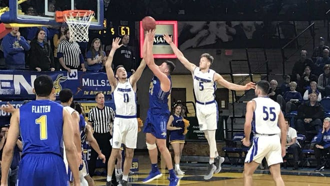SDSU's Mike Daum goes up for a layup while Fort Wayne's Carl Dylan (11) and Jax Levitch (5) defend.