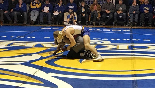 Seth Gross wrestles with Markus Simmons in their 133-pound match Sunday at Frost Arena.
