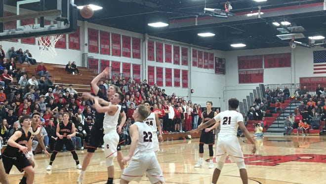 Marshfield's Seth Anderson puts up a shot in a Division 2 sectional final matchup against La Crosse Central at the SPASH Fieldhouse.