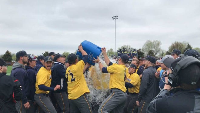 Augustana players douse coach Tim Huber with ice after winning the NSIC championship.