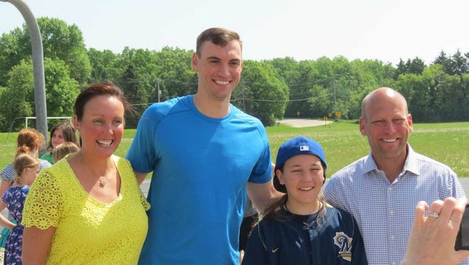 Jordan Young and her family took some time to take a photo with the Brewers' Brent Suter May 29. From left to right: Jennifer Young (Jordan's mother), Brent Suter, Jordan Young, and Jim Young (Jordan's father).