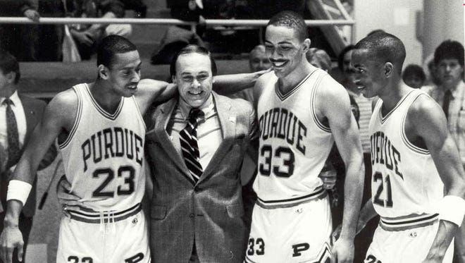 Purdue coach Gene Keady celebrates the 1988 Big Ten championship with Troy Lewis (23), Todd Mitchell (33) and Everette Stephens