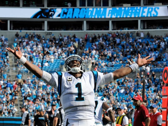Carolina Panthers' Cam Newton (1) celebrates a touchdown against the San Francisco 49ers in the second half of an NFL football game in Charlotte, N.C., Sunday, Sept. 18, 2016. (AP Photo/Mike McCarn)