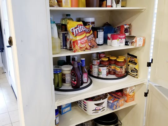 Christina Bozenka created a super inexpensive and convenient pantry for her kitchen from an entertainment center.