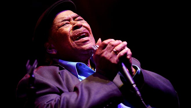 In this June 13, 2014 file photo, blues legend James Cotton ferociously plays the harmonica as he entertains the crowd at the W.C. Handy Blues and Barbecue Festival in Henderson, Ky.