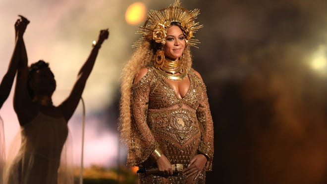 Beyoncé loves a good headdress. Here's the one she wore at the Grammys.