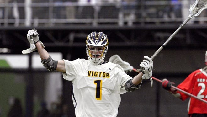 Victor's Mitchell Cain celebrates scoring the Blue Devils' third goal during the season opener against Jamesville-Dewitt played at the Pinnacle Athletic Campus, Thursday, March 29, 2018. Victor beat Jamesville-Dewitt 13-10.