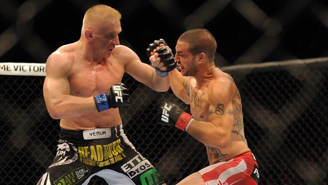 Dennis Siver, left, blocvks a punch by Cub Swanson during featherweight bout at UFC 162 in 2013.