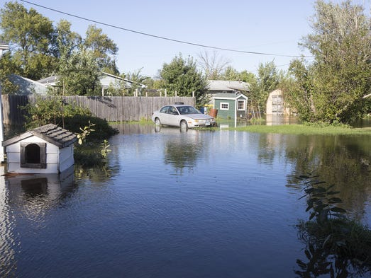Floodwaters rise in Palo neighborhoods, Monday, Sept.
