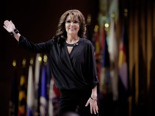 Palin waves as she leaves the stage during the Conservative Political ...