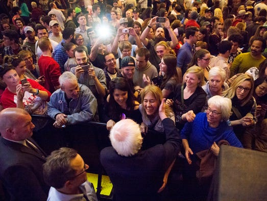 Sanders greets the crowd at a packed State Theatre