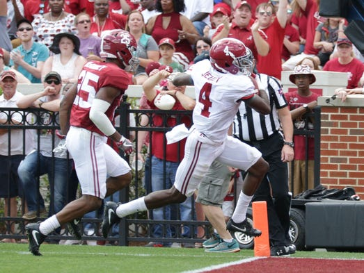 Alabama receiver Jerry Jeudy (4) sprints in for a touchdown