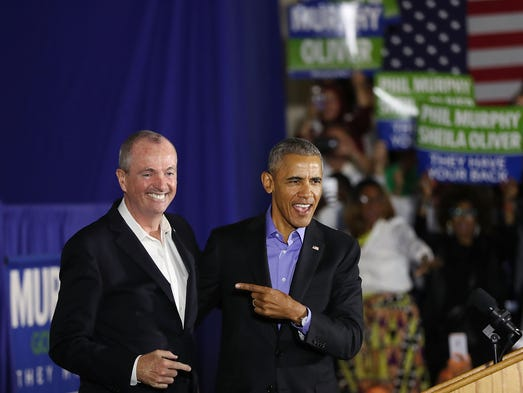 Obama stands on stage with Democratic candidate Phil