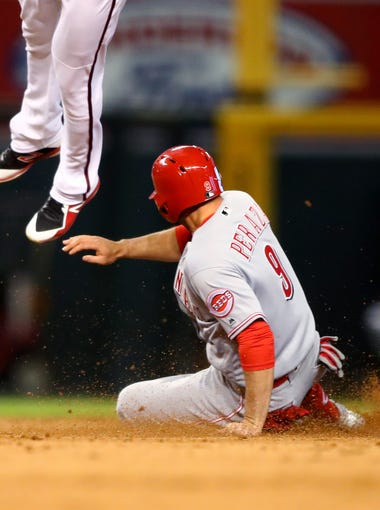 May 30, 2018; Phoenix, AZ, USA; Cincinnati Reds base runner Jose Peraza slides safely into second base with a stolen base in the sixth inning against the Arizona Diamondbacks at Chase Field. Mandatory Credit: Mark J. Rebilas-USA TODAY Sports