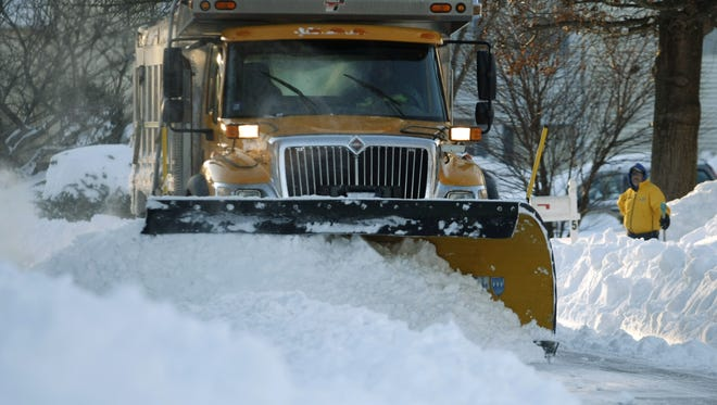 A Tinton Falls Public Works Department snow plow, clears mounds of snow from Clydesdale Ct. in Tinton Falls, after the weekend Blizzard, Monday, December 27, 2010. TINTON FALLS- #1227 - NEWS - 12/267/10.