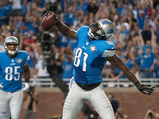 Detroit Lions wide receiver Calvin Johnson (81) celebrates his touchdown during the first quarter against the New York Giants at Ford Field.