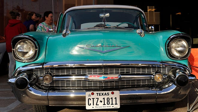 A 1957 Chevrolet Bel Air sits on display during the 2014 CarWalk in downtown Abilene.