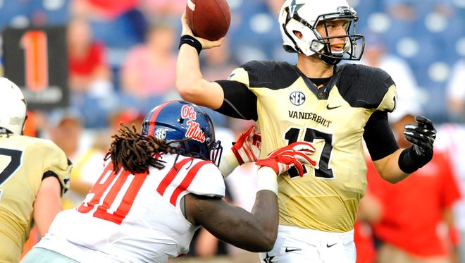 Defensive end Fadol Brown (90) hits Vanderbilt quarterback Stephen Rivers (17) as Rivers throws the ball during the second half at LP Field.